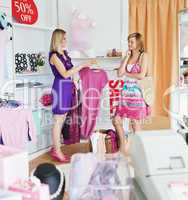 Teen women choosing clothes together
