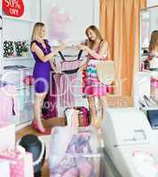 Young women choosing clothes together