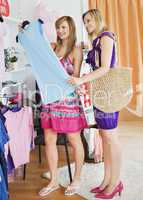 United women choosing clothes together