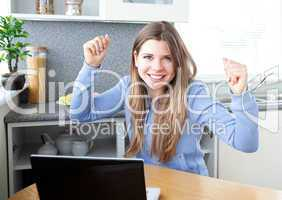 Cheering girl in front of her laptop