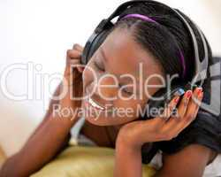 Kind woman listening to music