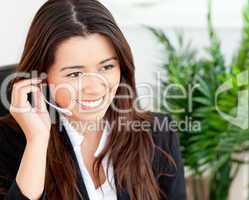 Pretty businesswoman using headset