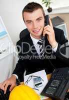 Handsome businessman using phone