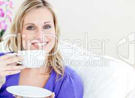 Simper woman holding cup