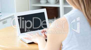Sweet woman sitting in front of her laptop