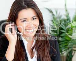 Confident asian businesswoman wearing headphones