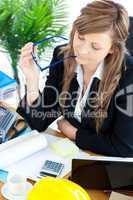 Busy businesswoman sitting a her desk