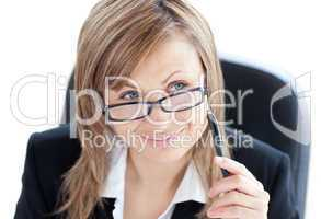 Charismatic businesswoman holding a pen wearing glasses