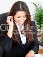 Self-assured asian businesswoman wearing headphones