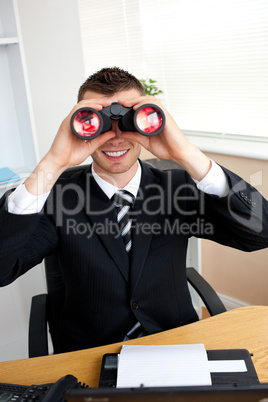 Smiling businesswoman with binoculars