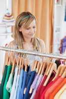 Captivating young woman choosing a colorful shirt