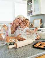 Laughing woman baking cookies with her daughter