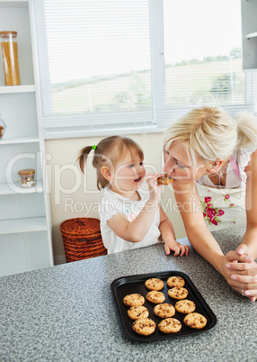 Pretty mother baking cookies with her daughter