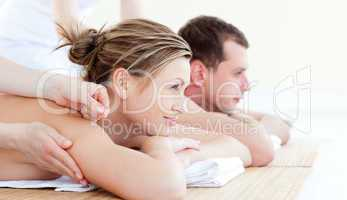 Attractive young couple having an acupunctre therapy