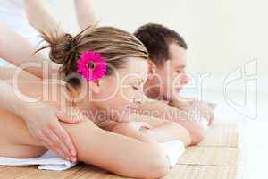 Relaxed couple having a back massage