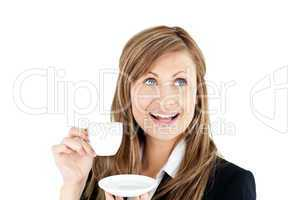 Elegant young businesswoman holding a cup of coffee
