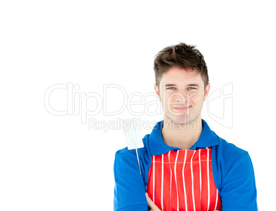 Charming young cook holding a cookware against white background