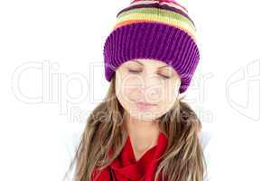 Depressed young woman wearing a cap and scarf