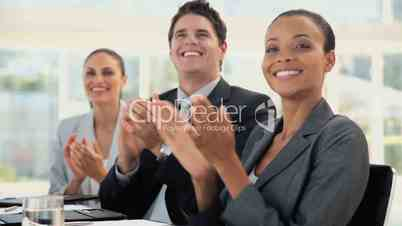 Business Team Smile and Clap at a Meeting