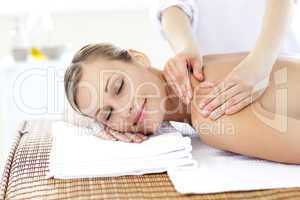 Caucasian young woman enjoying a back massage