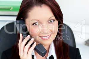 Confident young businesswoman talking on phone
