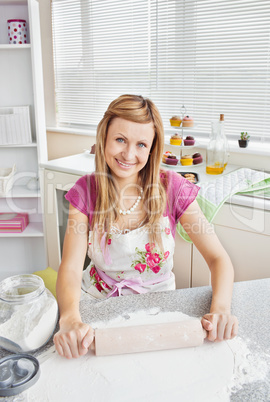 Portrait of a beautiful woman baking in the kitchen