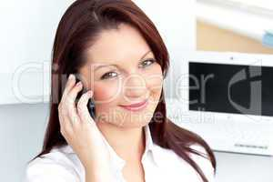 Elegant businesswoman talking on phone smiling at the camera