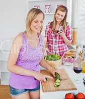 Cheerful women cooking together at home