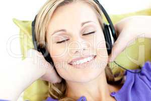 Delighted woman listening to music in the living-room