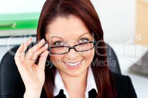 Assertive businesswoman wearing glasses