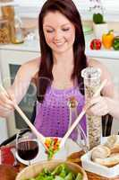 Positive woman eating her healthy meal at home