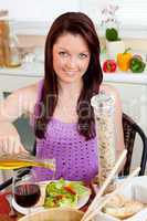 Bright woman eating her healthy meal at home