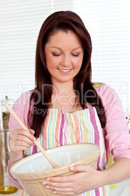 Confident woman cooking a cake at home