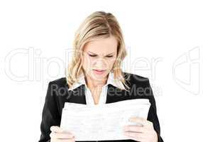 Depressed businesswoman holding a newspaper