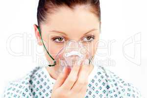 Female patient with an oxygen mask