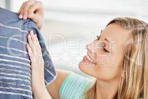 Concentrated young woman sewing clothes at home