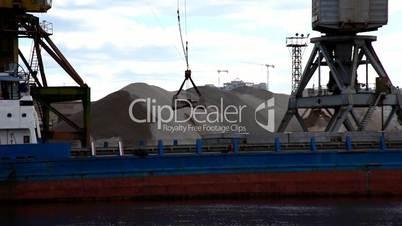 ship's crane unloads sand