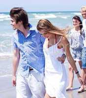 Romantic couples walking down the beach