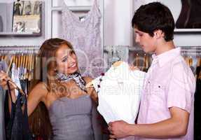 Attractive young couple in clothes department