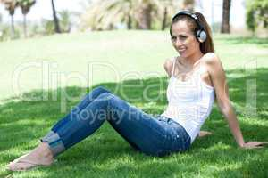 Young woman listening to music and relaxing