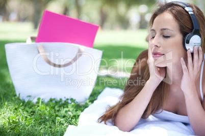 Graceful women listening music with hand bag