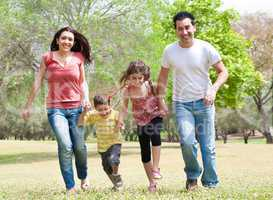 Family running on the park