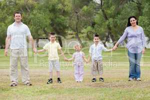 Happy family holding hands