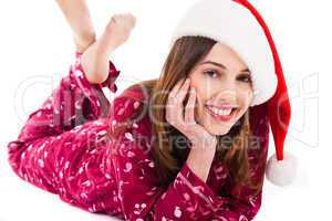 Santa girl relaxing by lying down and smiling