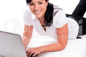 Young happy business woman working with the laptop