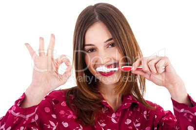 Women brushing her teeth and showing perfect gesture