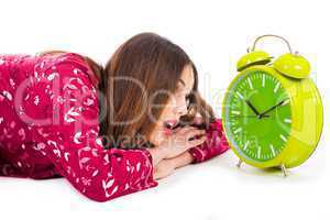 Girl looking into the alarm while its ringing