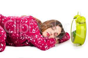 Pretty women sleeping with the alarm beside her