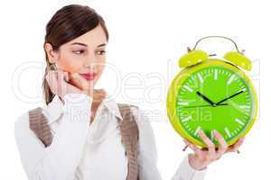 young beautiful brunette holding the clock and seeing