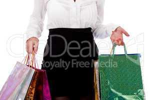 Woman holding shopping bags half length shot